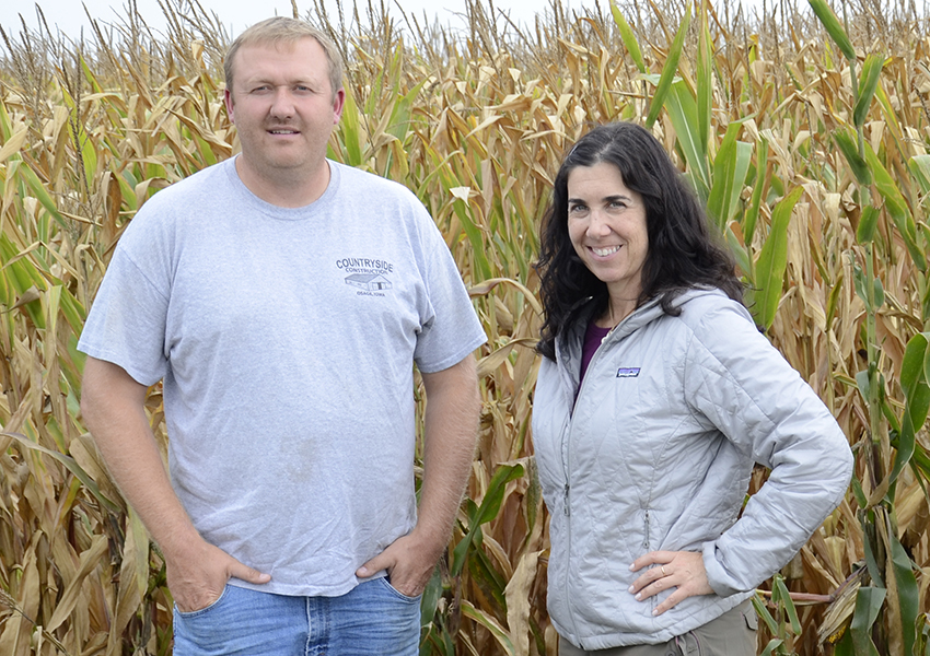Farmer Bill Newton works for good yields with a conservation mindset. Here, he and Ruth Rabinowitz inspect a healthy 2015 crop on the Rabinowitz Farm in Mitchell County, Iowa.